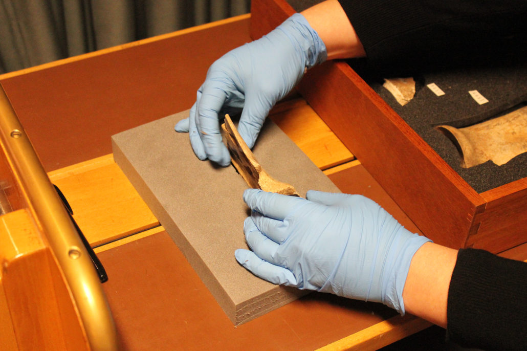 British Library conservator Karen Bradford stabilising an oracle bone in a foam stand before imaging