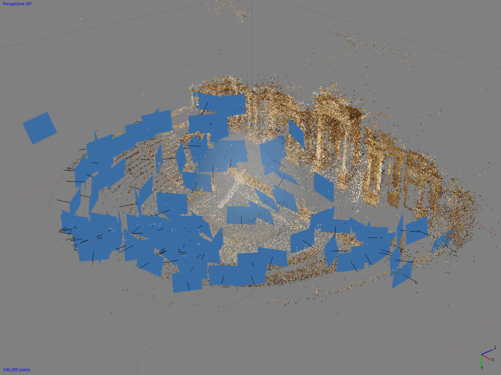 An image showing a point-cloud of the Roman Theater. The blue rectangles are the camera locations important in generating a photogrammetry solve.